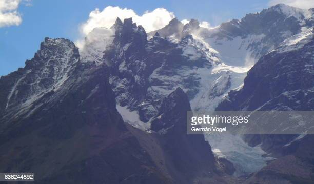Snowed Andes mountain peaks - Torres del Paine, Chile