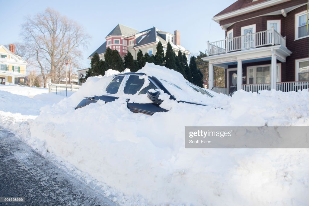 A snowed in vehicle is left parked the day after the region was hit with a 'bomb cyclone' on January 5, 2018 in the Dorchester neighborhood of Boston, Massachusetts. Schools and businesses throughout the Boston area get back to work today after the city received over a foot of snow during the fast moving storm yesterday.