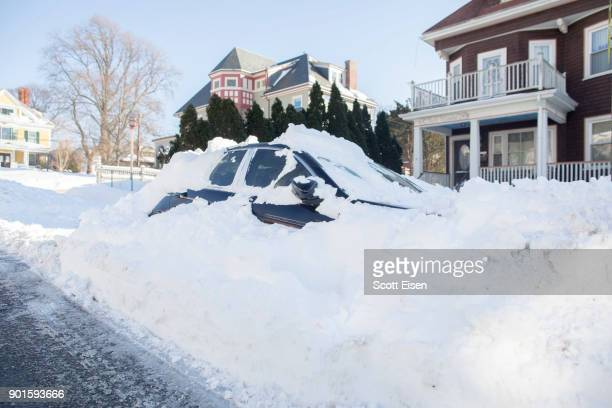 A snowed in vehicle is left parked the day after the region was hit with a bomb cyclone on January 5 2018 in the Dorchester neighborhood of Boston...