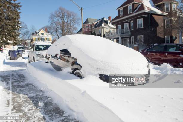 A snowed in vehicle is left parked the day after the region was hit with a 'bomb cyclone' on January 5 2018 in the Dorchester neighborhood of Boston...