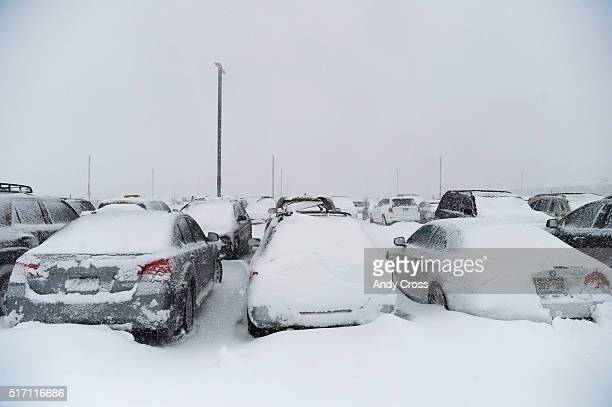 Snowed in vehicles on top of the west side parking garage at Denver International Airport March 23 2016