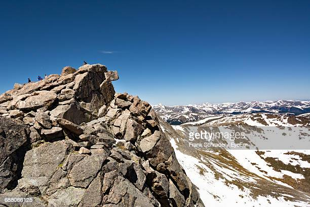 snowed rocky landscape against blue sky - frank schrader stock pictures, royalty-free photos & images