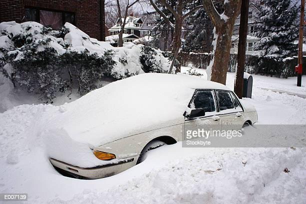 Snowed-in car in driveway