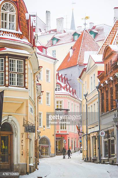 snowfall in old town. - estonia stock photos and pictures