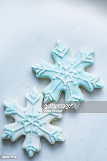 snowflake cookies on white pastel background - christmas background stock photos and pictures