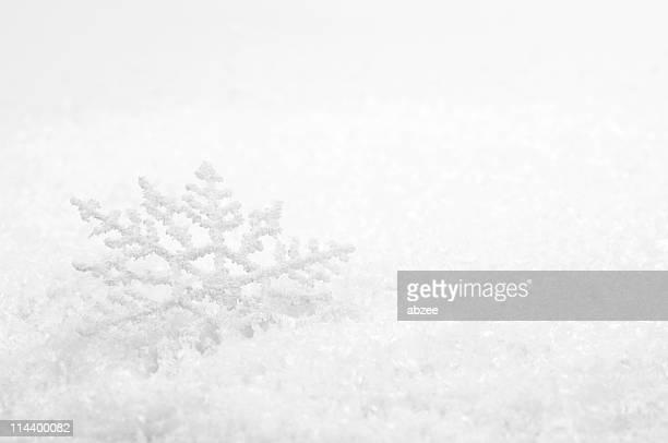 Snowflake decoration on snow for Christmas