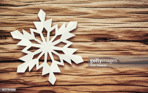 snowflake driftwood - snowflakes stock photos and pictures