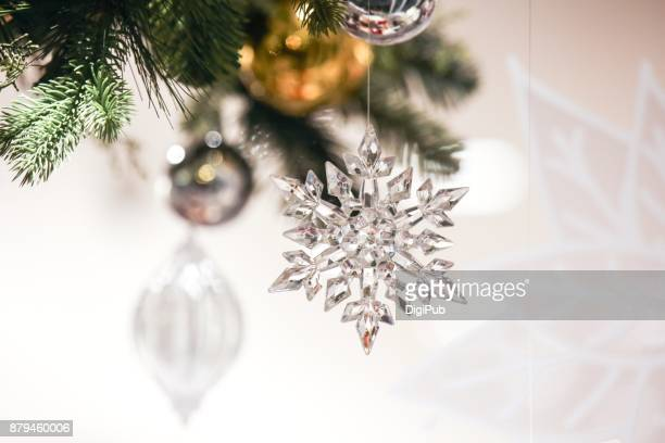 Snowflake hanging with baubles as Christmas decoration