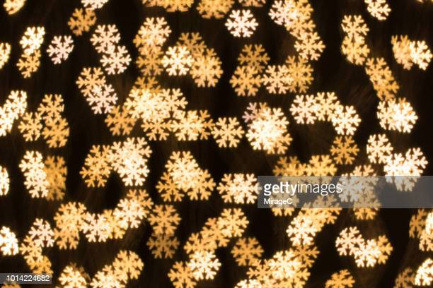 snowflake shape bokeh backdrop - snowflake background stock photos and pictures