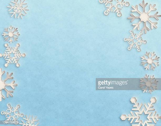 snowflakes frame in  pastel blue paper cut - felt textile stock pictures, royalty-free photos & images