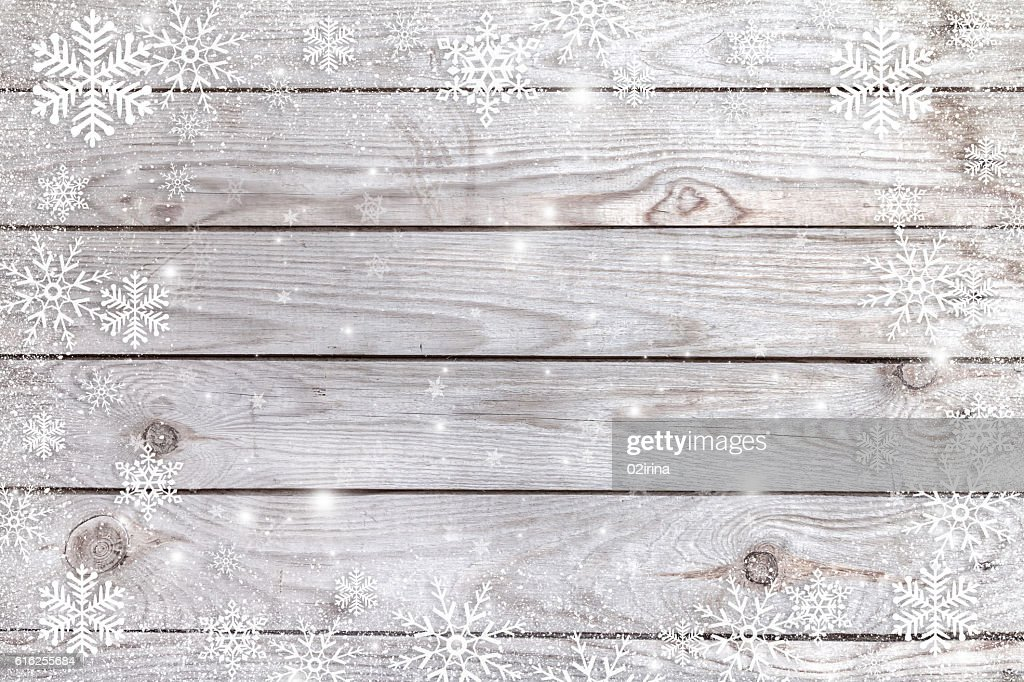Snowflakes on a wooden background. : Stock Photo