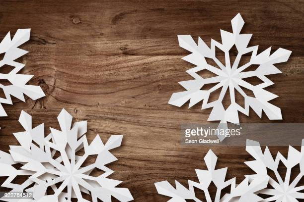 snowflakes on desk - invitation stock pictures, royalty-free photos & images