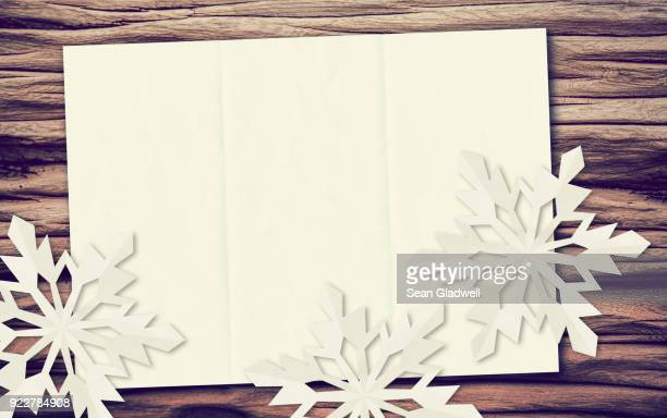 snowflakes paper driftwood - holiday card stock photos and pictures