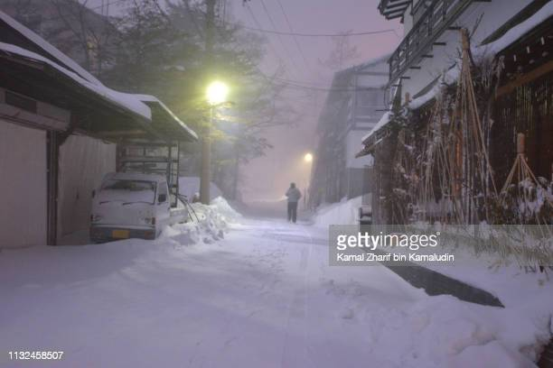 snowing at japan rural area - chilly bin stock photos and pictures