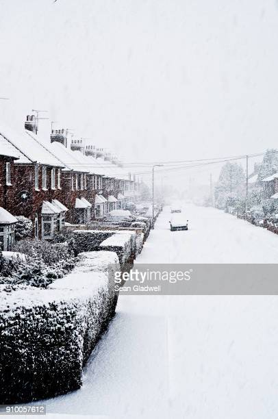 snowing in street - deep snow stock pictures, royalty-free photos & images