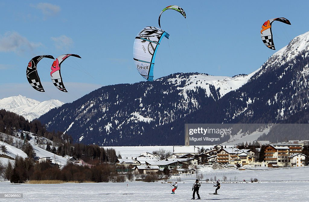 Snowkiters ride on the frozen lake Haidersee on January 31, 2010 in Graun im Vinschgau, Italy. Snowkiting is an outdoor winter sport where people uses kite power to glide on snow or ice.