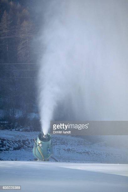 Snowmaking machine on a mountain slope