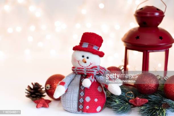 snowman and christmas ball on snow - snowman stock pictures, royalty-free photos & images