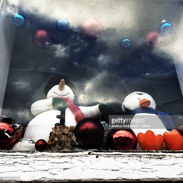 Snowman And Penguin Displayed At Store Window During Christmas