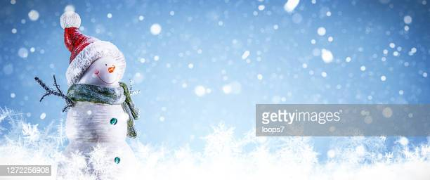 snowman and snowing background - free wallpapers stock pictures, royalty-free photos & images