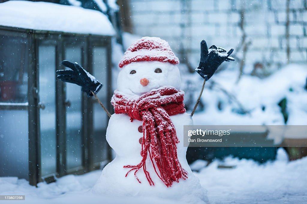 Snowman built on city street : Stock Photo