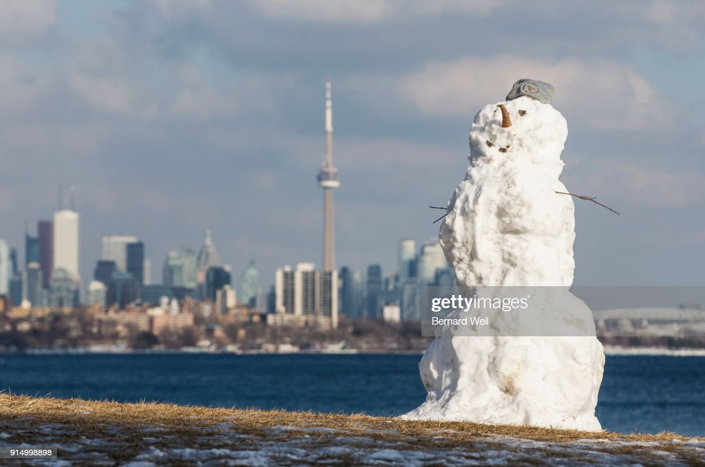 Snowman frames Toronto skyline. Pictures | Getty Images