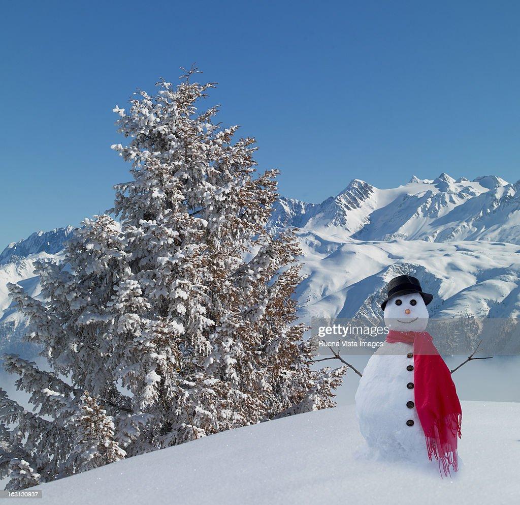 Snowman in snowy mountains. : ストックフォト