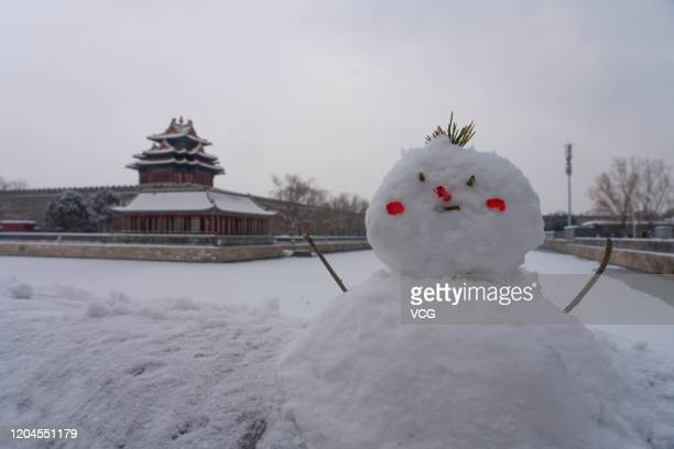A snowman is pictured outside the Forbidden City on February 6 2020 in Beijing China A heavy snow hits Beijing again on Wednesday and Thursday