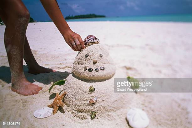 Snowman Made of Sand and Sea Shells