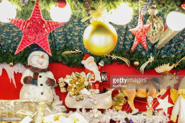 Snowman Santa Claus with light on a sled with presents pulled by a reindeer Christmas Market in the Northern Bavarian town of Bayreuth