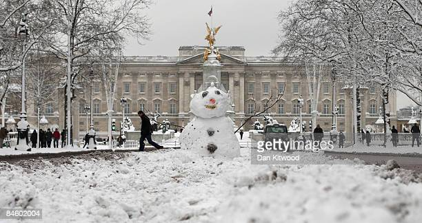 A snowman sits in front of Buckingham Palace on The Mall after a night of heavy snow on February 2 2009 in London England Heavy snow has fallen...