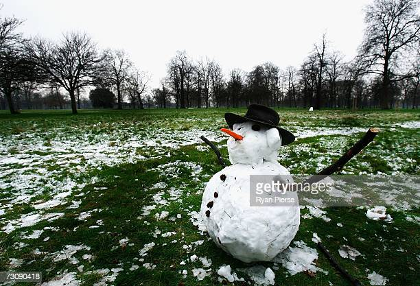 A snowman sits in the melting snow in Hyde Park on January 24 2007 in London England After a prolonged mild period winter has finally arrived in the...