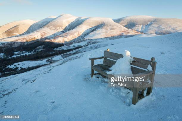A snowman sits on a bench on Latrigg on February 7 2018 near Keswick England Freezing conditions are continuing with forecasters predicting one of...