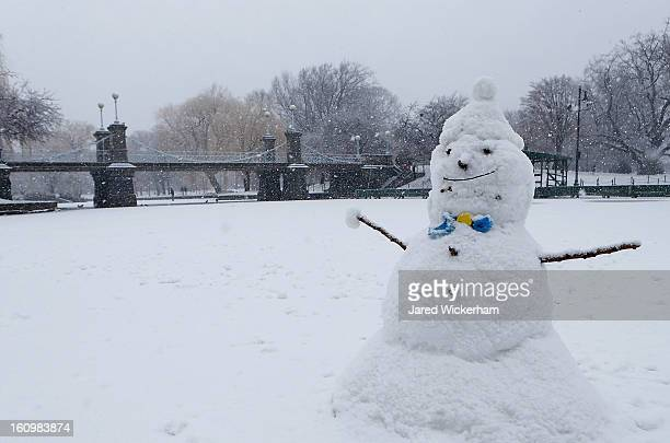 A snowman sits on the duck pond in the Boston Common as snow falls on February 9 2013 in Boston Massachusetts Massachusetts and other states from New...