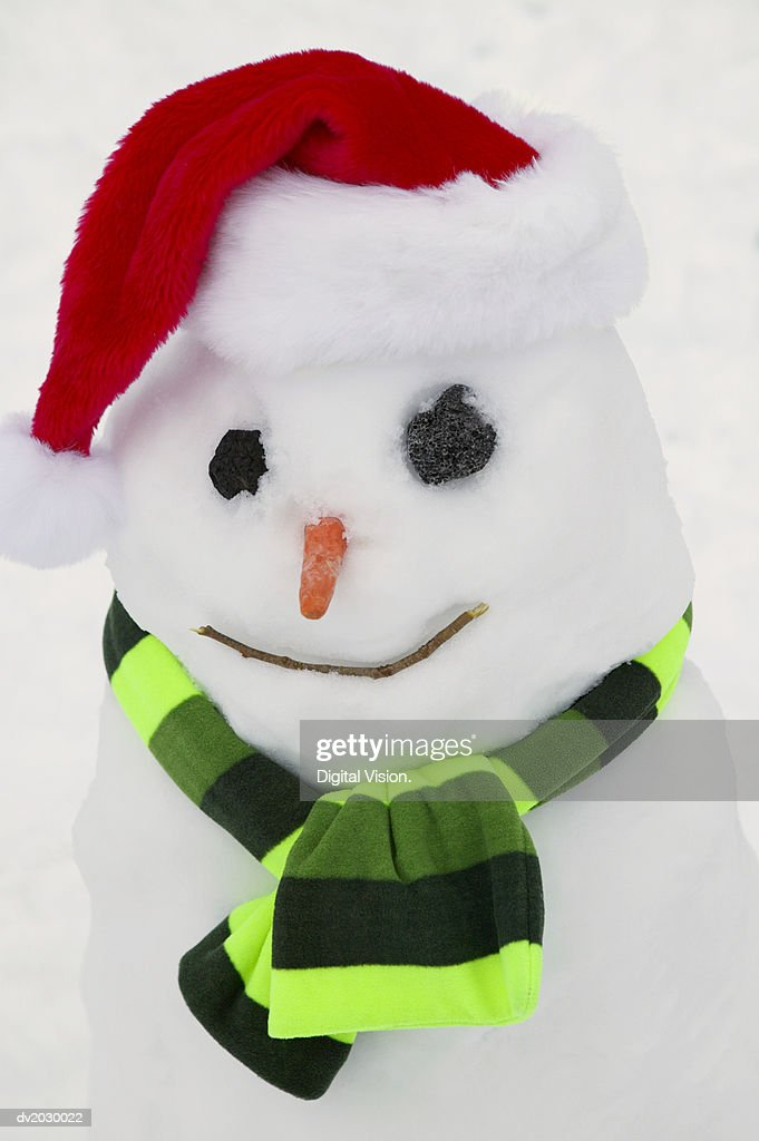 Snowman Wearing a Santa Hat : Stock Photo