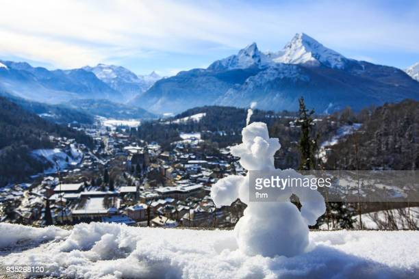 A snowman with Berchtessgaden and Mount Watzman in the background (Berchtesgadener Land/ Bavaria/ Germany)