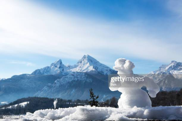 a snowman with watzman in the background (berchtesgadener land/ bavaria/ germany) - upper bavaria stock photos and pictures