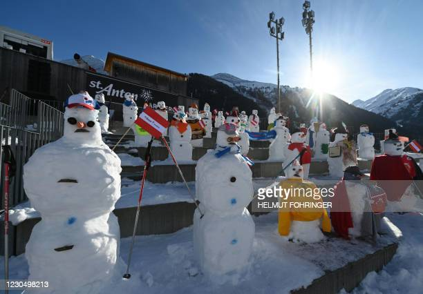 Snowmen instead of spectators are seen in the finish area of the women's downhill competition of the FIS Alpine Ski World Cup on January 9 in St...