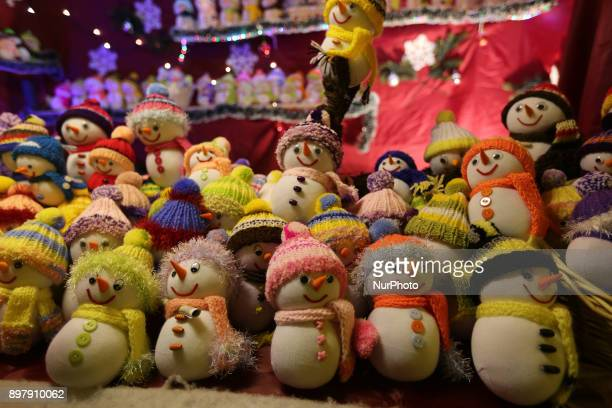 Snowmen sold by a stand on the last Day of the Christmas Market at quotChinesischer Turmquot in Munich on December 23 2017