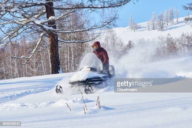 snowmobile driver having fun - cliqueimages stock pictures, royalty-free photos & images