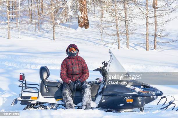 snowmobile driver resting after ride - cliqueimages stock pictures, royalty-free photos & images
