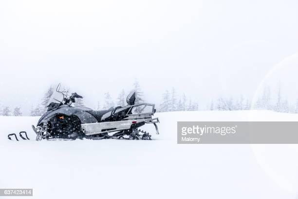 snowmobile on snowy landscape. snowstorm - snowmobiling - fotografias e filmes do acervo
