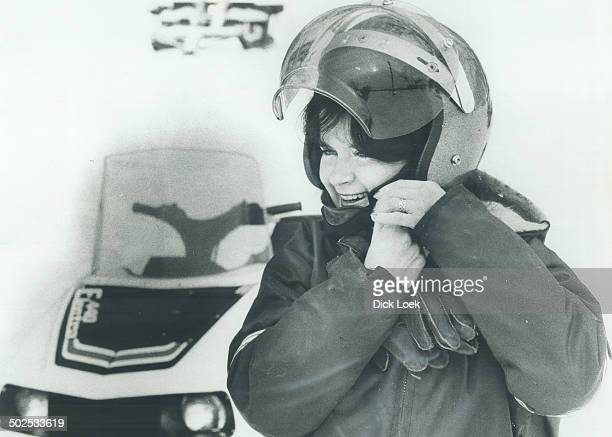 Snowmobiler Glenna Sears of Creemore buckles on her helmet before setting out at a snowmobile resort This is the first year the law has required...