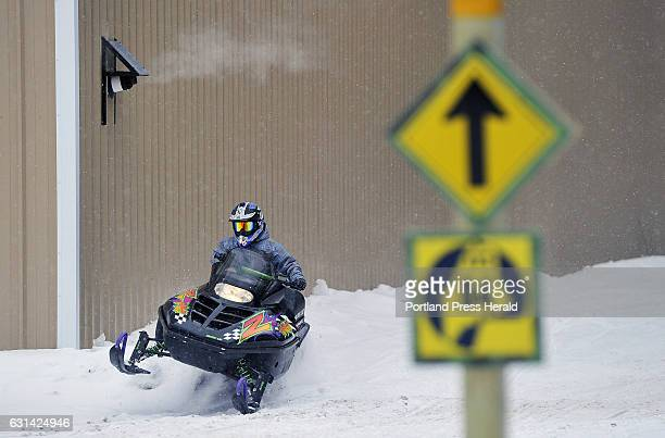 Snowmobiler makes his way into the village of Oquossoc in the town of Rangeley Wednesday December 28 2016