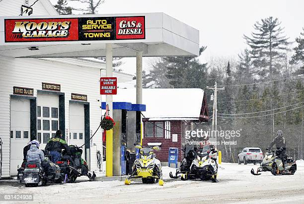 Snowmobilers line up for gas at Koob's Garage in the village of Oquossoc in the town of Rangeley Wednesday December 28 2016