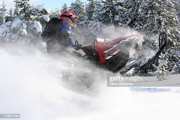 Snowmobiling and skiing are different sports but they share a love of powder