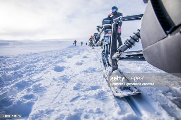 snowmobiling at bjorkliden, lapponia, arctic circle, northern sweden. - swedish lapland stock photos and pictures
