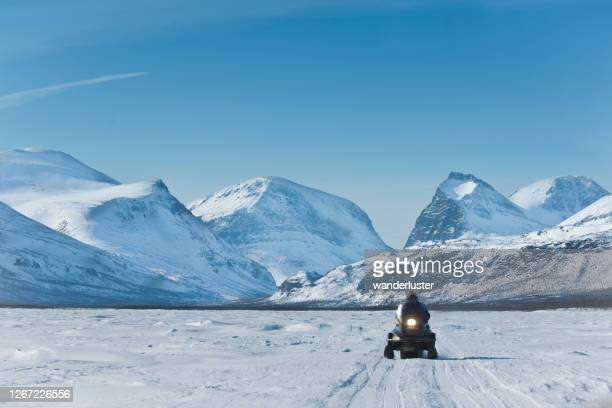 snowmobiling in northern sweden - norrbotten province stock pictures, royalty-free photos & images