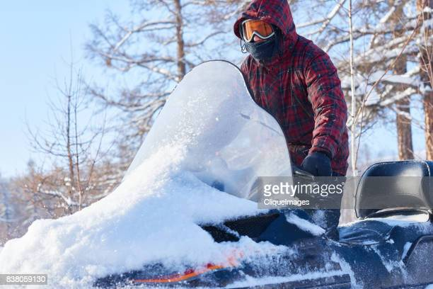 snowmobiling on beautiful winter day - cliqueimages stock pictures, royalty-free photos & images