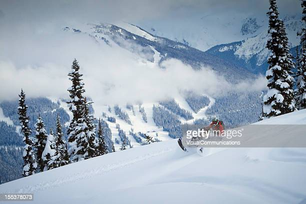 Snowmobiling on the top of the snowy mountain